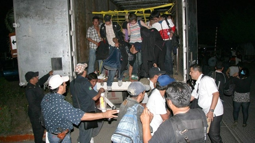 May 17: A group of illegal immigrants, seen here, were found inside a truck in Tuxtla Gutierrez, northern Mexico. Authorities detected two trucks with 513 immigrants from at least nine countries while the vehicles crossed a checkpoint with X-ray monitoring systems.  (EPA)