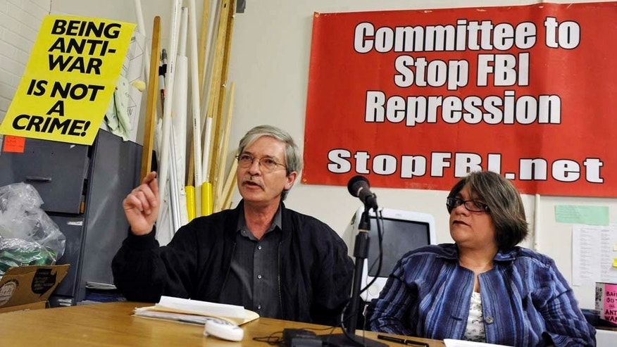 Long-time anti-war activist Mick Kelly talks about FBI documents left behind in a raid last September on his home in Minneapolis after raids on several anti-war activists, including Jess Sundin, right, during a news conference Wednesday, May 18, 2011 in Minneapolis. (AP Photo/Jim Mone)