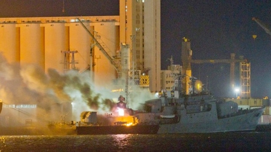 May 20: Smoke and flames pour from the Libyan Navy frigate Al Ghardabia, after it was hit during an airstrike by Tornado bombers of Britain's Royal Force on the port area of Tripoli.