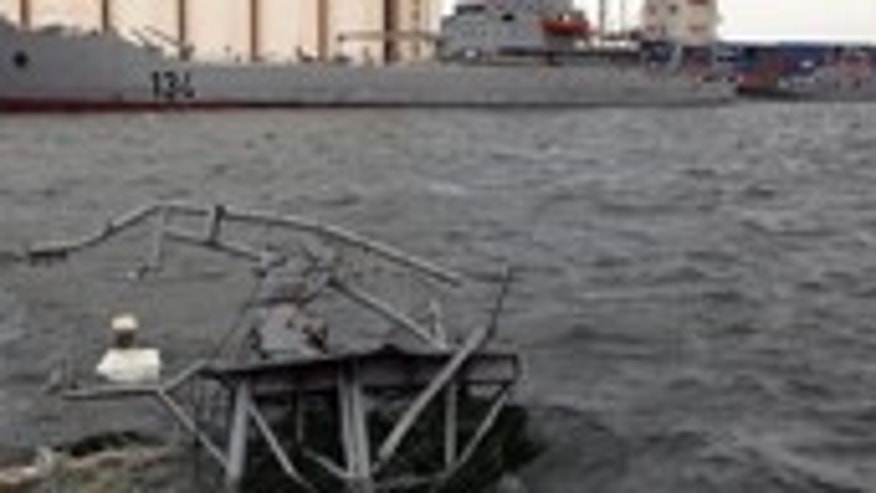 May 20: In this photo taken on a government organized tour, the top of a sunken boat is seen at the sea port in Tripoli, Libya.