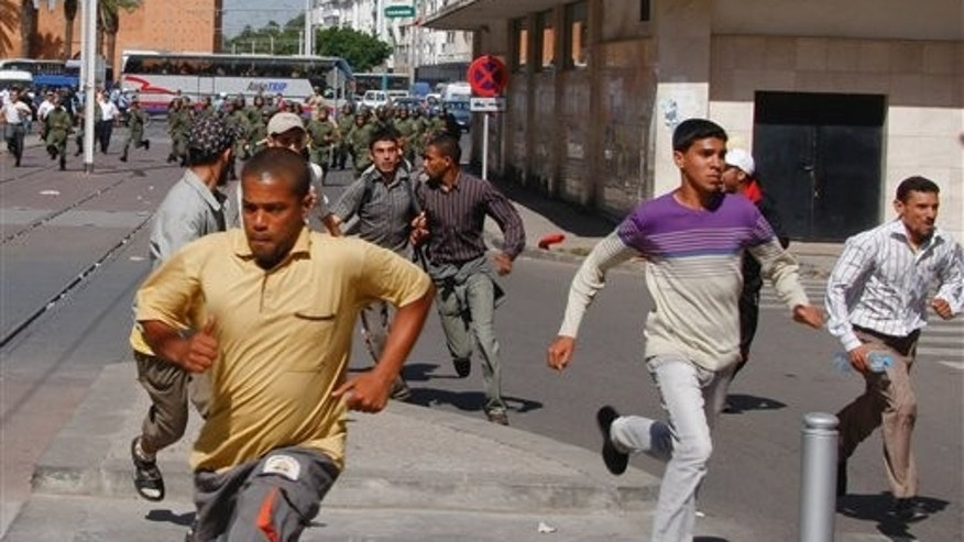 May 22: Moroccan police officers chase demonstrators as they break up a demonstration organized by the 20th February, the Moroccan Arab Spring movement, in Rabat, Morocco, in a mass popular call to bring more democracy into this North African kingdom. (AP)