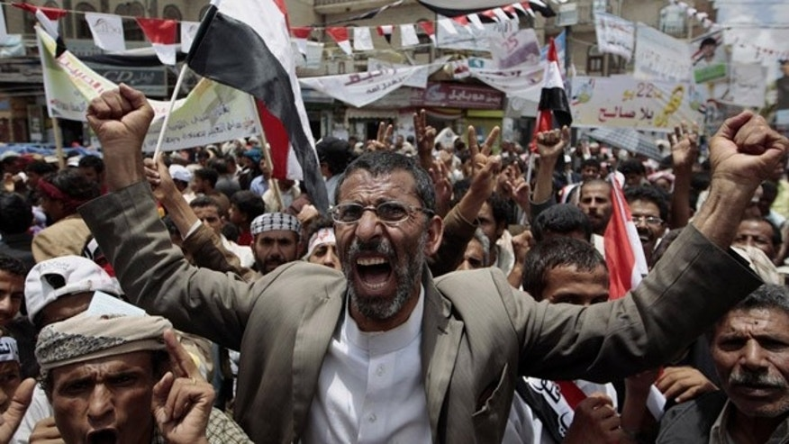 May 23: Anti-government protesters shout slogans during a rally to demand the ouster of Yemen's President Ali Abdullah Saleh. France on Monday accused Saleh of being irresponsible by refusing to sign a power transition agreement that would see him step down.