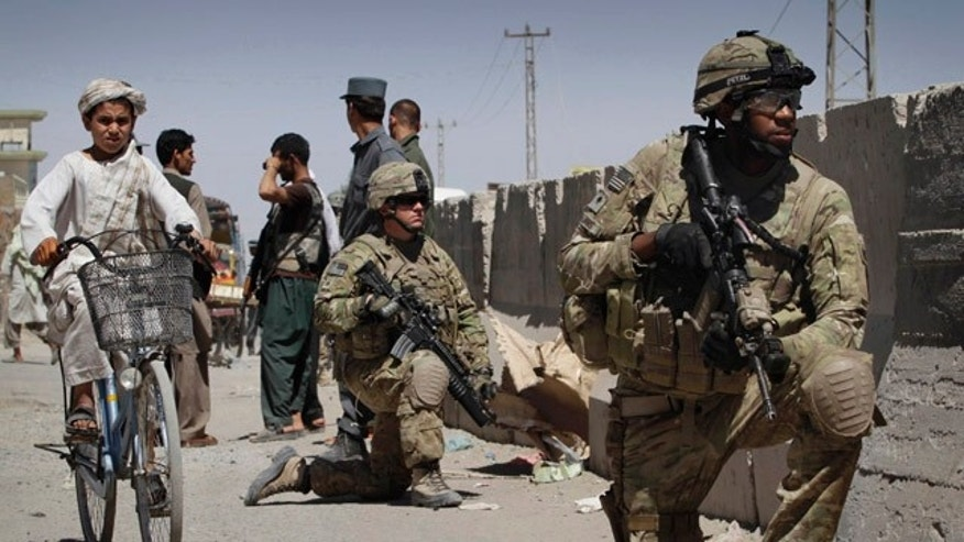 May 22: U.S. soldiers respond to an explosion in Kandahar, Afghanistan where two police officers suffered injuries from a motorcycle with explosives. In a separate incident, NATO says four of its service members have been killed by an explosion in eastern Afghanistan.