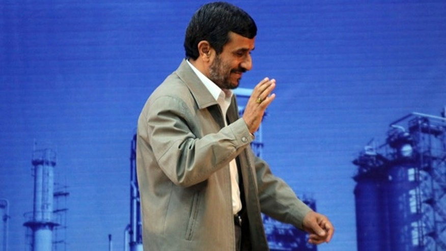 May 24: Iranian President Mahmoud Ahmadinejad waves at the conclusion of his speech at the oil refinery of the southwestern city of Abadan, Iran.