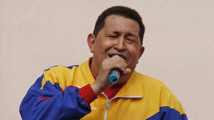 "Venezuela's President Hugo Chavez, right, sings next to his daughter Maria and grandson Jorge after his radio and television show ""Hello President"" at Miraflores presidential palace in Caracas, Sunday, May 22, 2011. Chavez appeared in public for the first time since injuring himself while jogging two weeks ago. (AP Photo/Fernando Llano)"