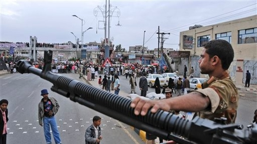 "May 25: A Yemeni army soldier stands guard at a checkpoint in Sanaa, Yemen. Yemen's embattled President Ali Abdullah Saleh issued messages of hard-line defiance Wednesday even as intense battles raged in the heart of the capital for a third day, saying he will not step down or allow the country to become a ""failed state."" (AP)"