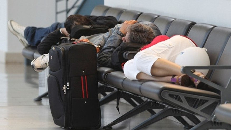 May 25: Passengers rest at the airport in Bremen, northern Germany, after flights were canceled due to elevated levels of ash in the atmosphere stemming from an Icelandic volcano.
