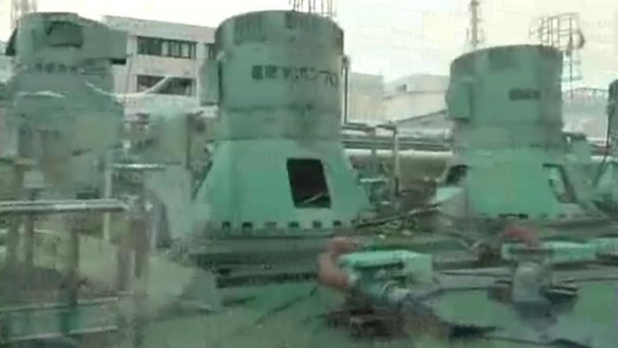 May 6: This photo released by Tokyo Electric Power Co. shows dust inhibitor being sprayed around the circulating water pump of Unit 3 the at crippled Fukushima Dai-ichi nuclear power plant in Okuma, Fukushima Prefecture, northeastern Japan.