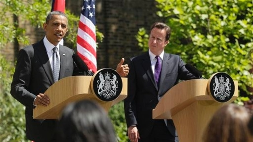 May 25: President Barack Obama and Britain's Prime Minister David Cameron participate in a joint news conference at Lancaster House in London.