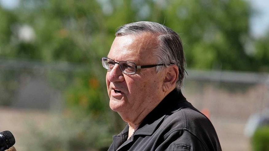 Maricopa County Sheriff Joe Arpaio, showcasing 2,300 lbs of seized marijuana, speaks to the media Thursday, May 12 2011 outside the Sheriff's training center in Phoenix. Sheriff Arpaio confirms two agents were killed in a freight train collision. And he says the FBI will be taking over the investigation. (AP Photo/Matt York)