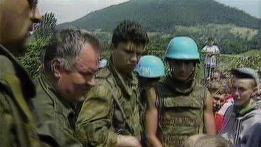 July 12, 1995: Bosnian Serb General Ratko Mladic pats a young Muslim boy on the head as he assures residents of Srebrenica they would be safe, after his arrival in Srebrenica, Bosnia. Gen. Ratko Mladic, the brutal Bosnian Serb general suspected of leading the bloody massacre of 8,000 Muslim men and boys, was arrested in an early morning raid Thursday May 26, 2011 in Serbia after more than a decade hiding from genocide charges, the country's president said.