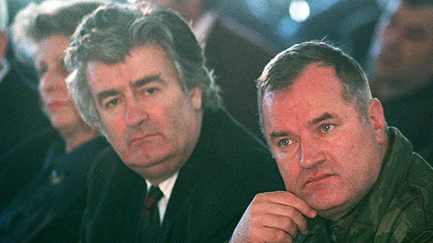 An undated file photo shows top war crimes fugitives Bosnian Serb wartime military commander Ratko Mladic, right, and political leader Radovan Karadzic. (AP/Srdjan Ilic)