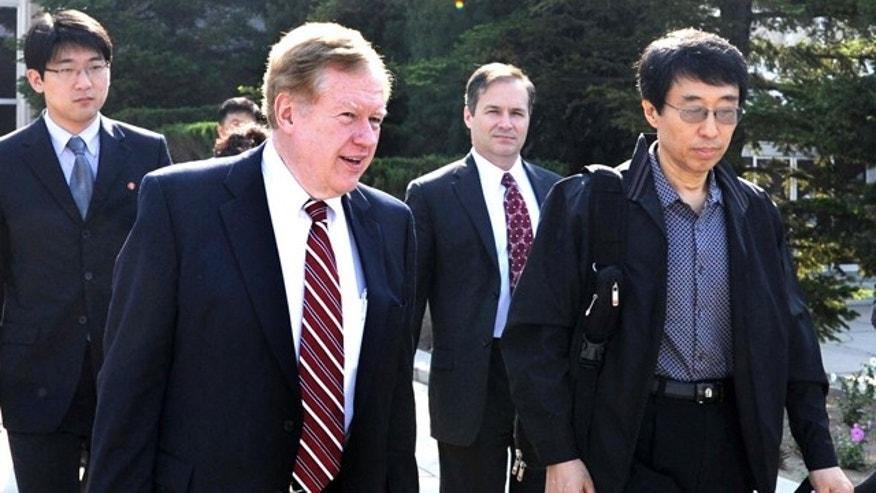 May 28, 2011: Robert King, left, U.S. special envoy for North Korean human rights issues, and U.S. citizen Eddie Jun, right, prepare to leave Pyongyang, North Korea.