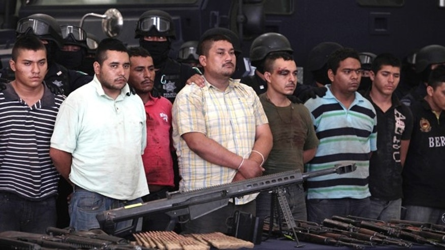 May 28: Federal police present to the news media a cache of weapons and nearly 50 suspects of two major drug cartels in Mexico City.