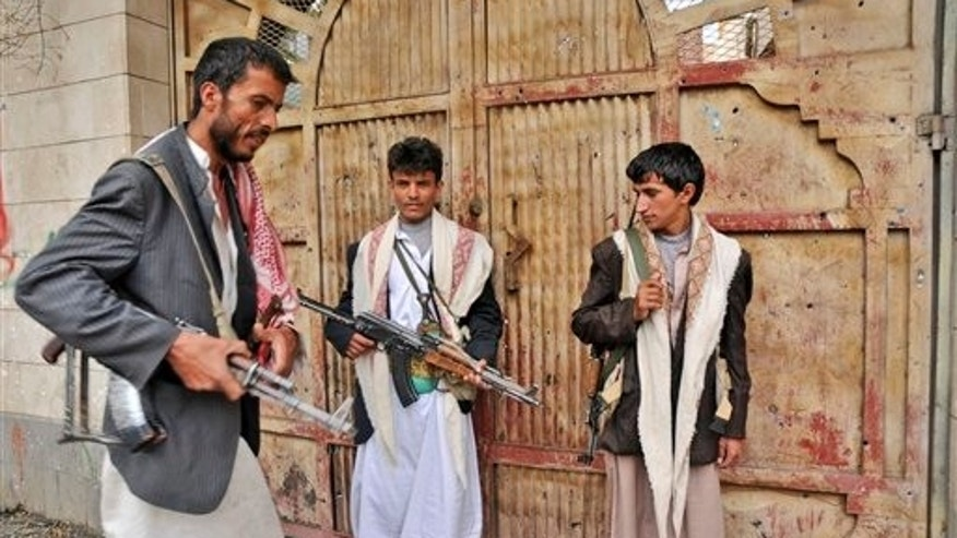 May 28: Armed tribesman loyal to Sheik Sadeq al-Ahmar, the head of the powerful Hashid tribe, stand guard a street in Sanaa, Yemen. Fighting that rocked Sanaa for the past five days spread beyond the capital on Friday as Yemeni tribesmen opposed to the rule of President Ali Abdullah Saleh seized a Republican Guard military camp in battles that left dozens dead and prompted airstrikes by government warplanes, according to a tribal leader. (AP)