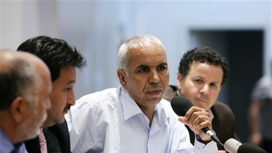 May 30: Defecting from Qaddafi's regime, Almbrok Ahmed Hmimida meets the journalists in Rome. Five Libyan army generals who defected from Muammar al-Qaddafi's side are appealing to fellow officers to join them in backing the rebels.  Italian foreign ministry officials presented the generals, two colonels and a major at a news conference in Rome Monday. Gen. Melud Massoud Halasa estimates Qaddafi's forces are only 20 percent as efficient as they were before the rebellion began and that at most 10 generals are still loyal to Qaddafi. (AP)
