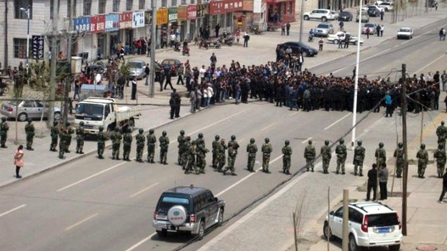 Southern Mongolian Human Rights Information Center, Chinese security personnel face off protesters on a street of Xilinhot in northern China's Inner Mongolia province. Authorities poured more police into the streets and slowed Internet service in several parts of China's Inner Mongolia on Monday, May 30, following days of protests believed to be the largest in the region in 20 years.