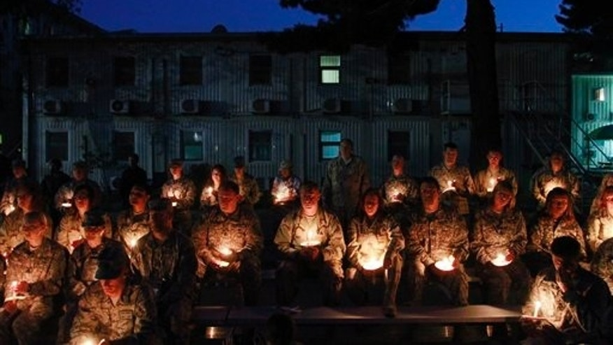 May 29: U.S. soldiers holds candles to mark the Memorial Day at the U.S. Army Corps of Engineers' headquarters in Kabul, Afghanistan. Some U.S. troops in Afghanistan have held a candlelit remembrance for those lost ahead of Memorial Day. (AP)