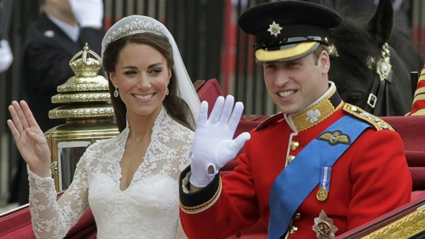 April 29: Kate tries out her new royal wave — and experienced royal William waves too — as the happy newlyweds leave Westminster Abbey after the ceremony.