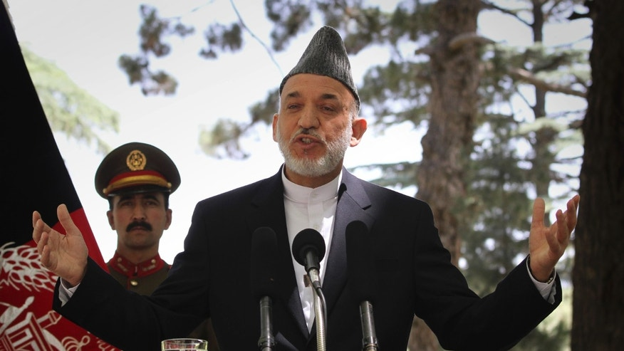 May 31: Afghan President Hamid Karzai gestures during a press conference at the presidential palace in Kabul, Afghanistan. Angered by civilian casualties, Karzai said Tuesday he will no longer allow NATO airstrikes on houses, issuing his strongest statement yet against strikes that the military alliance says are key to its war on Taliban insurgents. (AP)