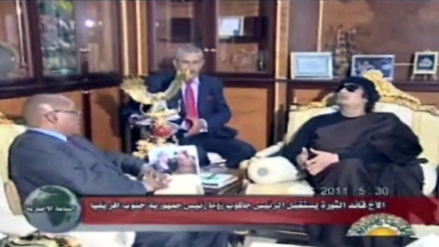 May 30: This video image taken from Libyan state television broadcast shows Libyan leader Muammar Qaddafi, right, and South African president Jacob Zuma, left, meet in Tripoli, Libya.