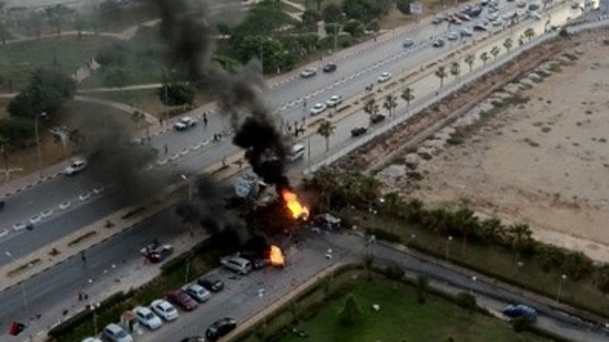 June 1: A car is seen burning after it exploded outside a hotel in Benghazi, Libya. (Fox News)