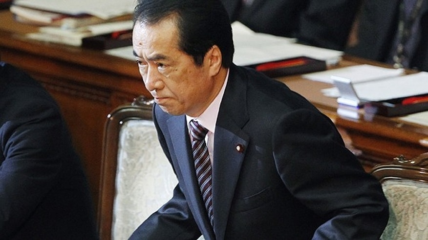 June 2: Japanese Prime Minister Naoto Kan leaves the plenary session at the lower house, after surviving a no-confidence motion against him in Tokyo, Japan.
