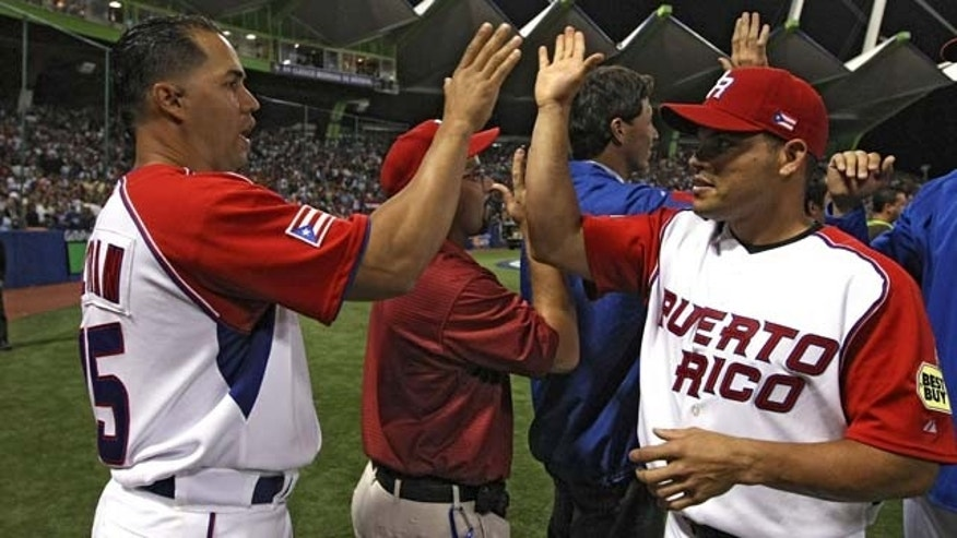 Carlos Beltrán, of the New York Mets, and Iván Rodríguez of the Washington Nationals, here playing with the Puerto Rico National team. They are two of only 20 Major League players from the Caribbean island who were on Opening Day rosters.