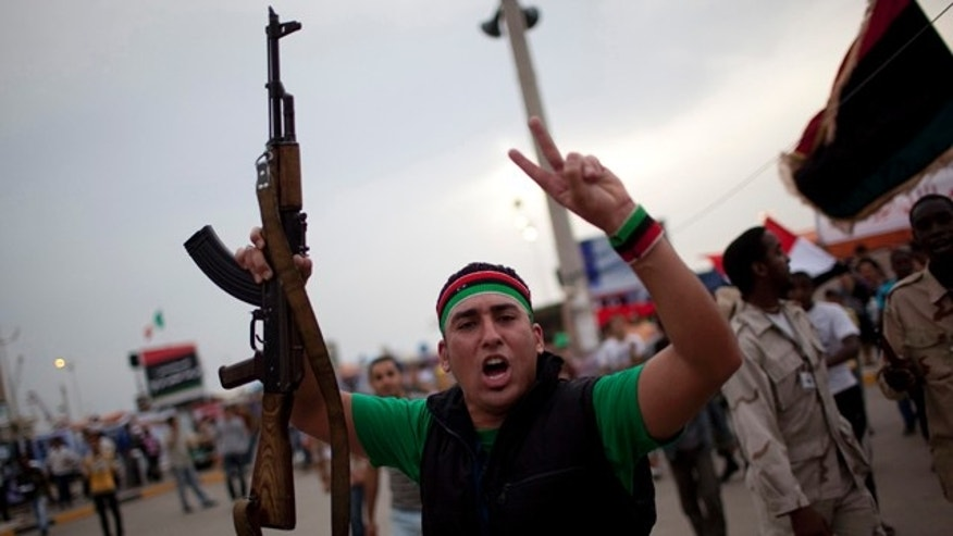 June 3: A man chants anti-Muammar al-Qaddafi slogans during a protest in the rebel strong hold of Benghazi, Libya.