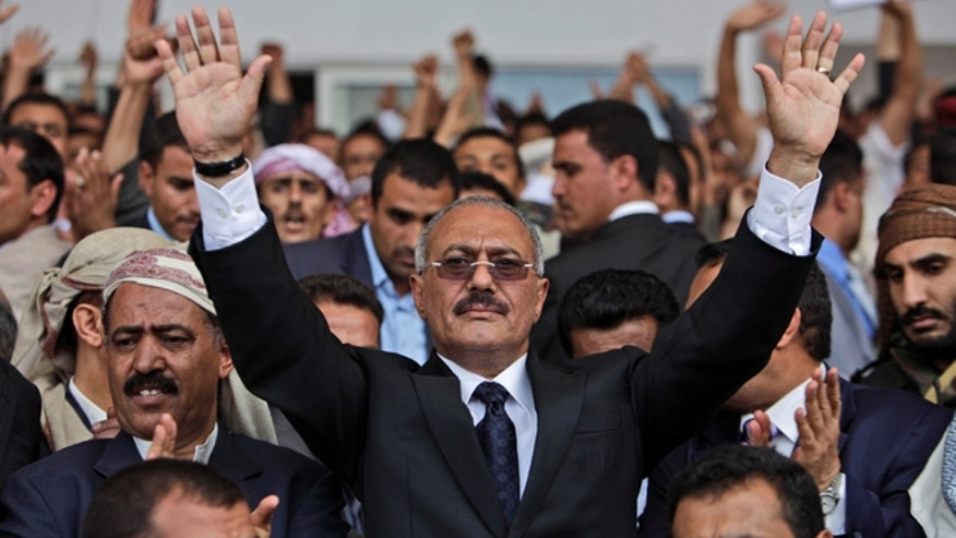 April 15: Yemeni President Ali Abdullah Saleh waves to his supporters during a rally in Sanaa, Yemen.