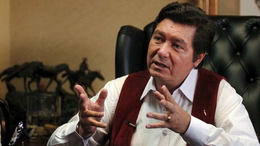 FILE - This June 13, 2006 file photo shows then Tijuana Mayor Jorge Hank Rhon in his City Hall office during an interview with The Associated Press, in Tijuana, Mexico. A Mexican official says that Hank Rhon has been arrested on suspicion of illegal weapons possession.