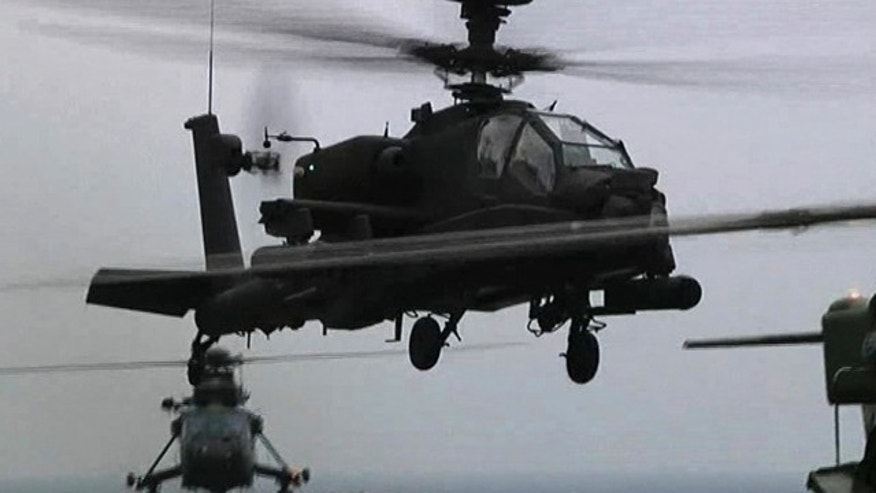 June 4: This image taken from video and made available by the British Ministry of Defense, MOD, shows a British Apache helicopter taking off from the deck of the HMS Ocean in the Mediterranean Sea, off Libya.
