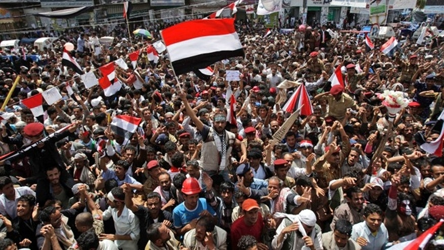 June 5: An anti-government protestor, center, waves his national flag while celebrating with others President Ali Abdullah Saleh's departure to Saudi Arabia, in Sanaa, Yemen.