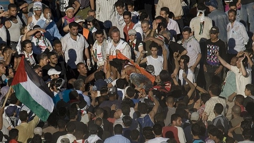 June 5: Pro-Palestinian protesters carry a dead person after he was shot by Israeli troops during a protest marking the anniversary of the Arab defeat in the 1967 Mideast war along the border between Israel and Syria near the village of Majdal Shams in the Golan Heights.