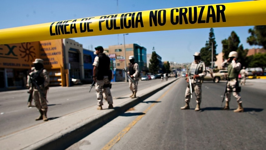 June 4: Mexican army soldiers guard the perimeter around the regional  Attorney General's office after the early morning arrest of former Tijuana Mayor Jorge Hank Rohn in the city of Tijuana, Mexico. (AP Photo/Francisco Vega)