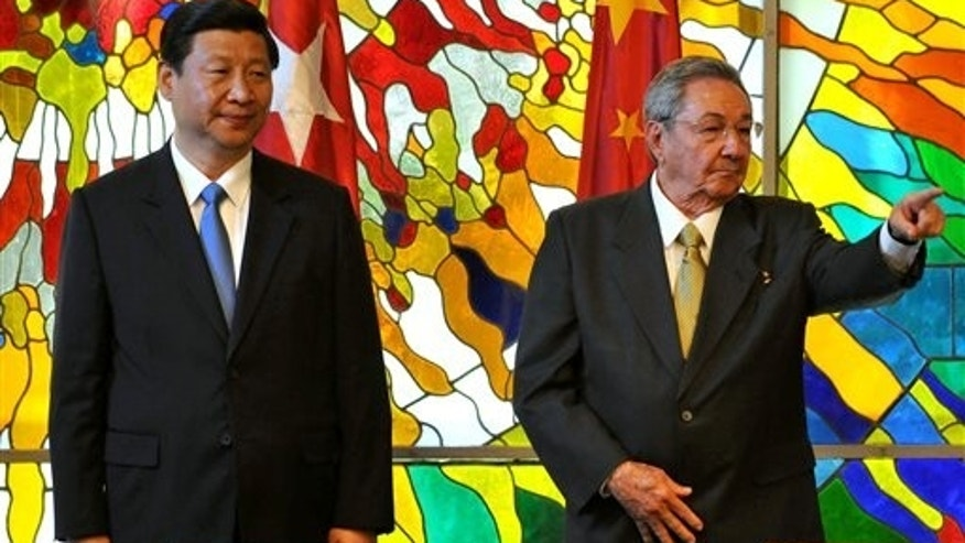 China's Vice President Xi Jinping, left, and Cuba's President Raul Castro attend a meeting at Revolution Palace in Havana, Cuba, Sunday June 5, 2011. Jinping is in Cuba on a two day official visit. (AP Photo/Alejandro Ernesto, Pool)