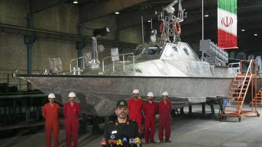 Aug. 23, 2010: Iran's Defense Minister Ahmad Vahidi speaks as he stands in front of a patrol vessel, a new generation Zolfaqar, that is equipped with missile and heavy automatic machine-gun systems for use in attacks against enemy ships at an Iranian defense industry complex in southwestern Tehran.