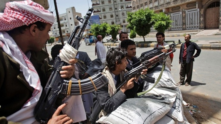 June 6: Armed tribesmen, loyal to Sheik Sadeq al-Ahmar, the head of the powerful Hashid tribe, stand guard in a street corner around al-Ahmar's house during clashes with Yemeni security forces in Sanaa, Yemen.