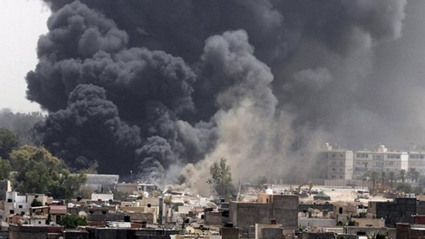 June 7: Smoke rises after coalition airstrikes in Tripoli.