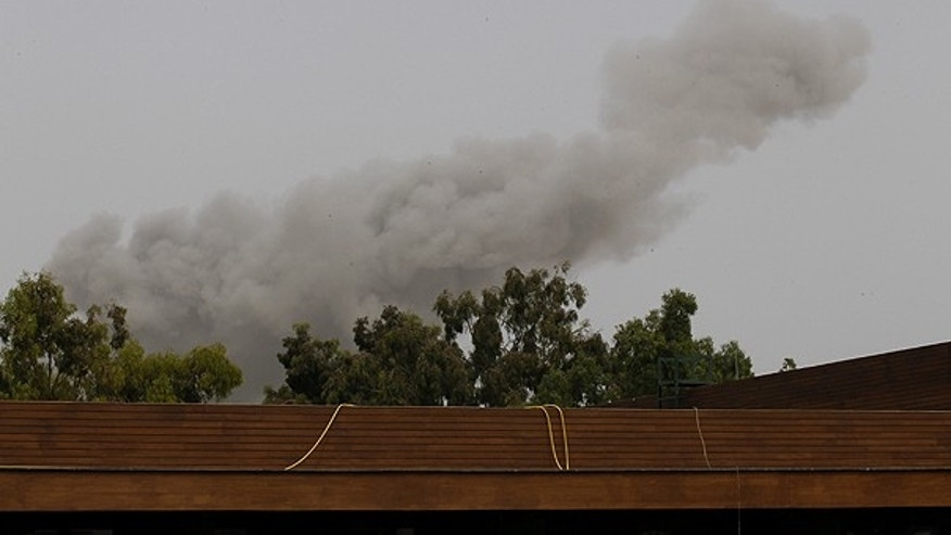 June 7: A smoke plume rises into the sky over Tripoli, Libya, following an airstrike. Low-flying NATO military craft have struck seven times in loud, banging succession over the Libyan capital Tripoli.