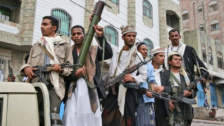 June 8: Armed Yemeni tribesmen stand on the back of a vehicle in Taiz, Yemen.