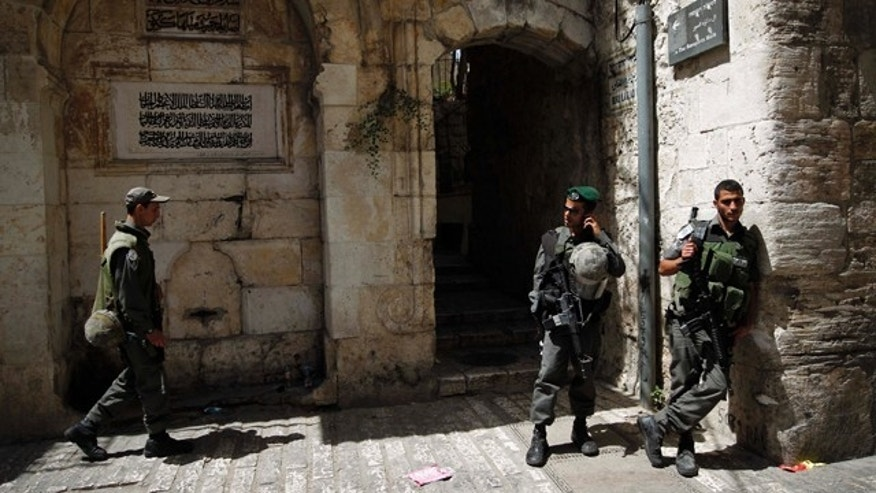 June 10: Israeli border police stand guard inside Jerusalem's Old City after Friday prayers.