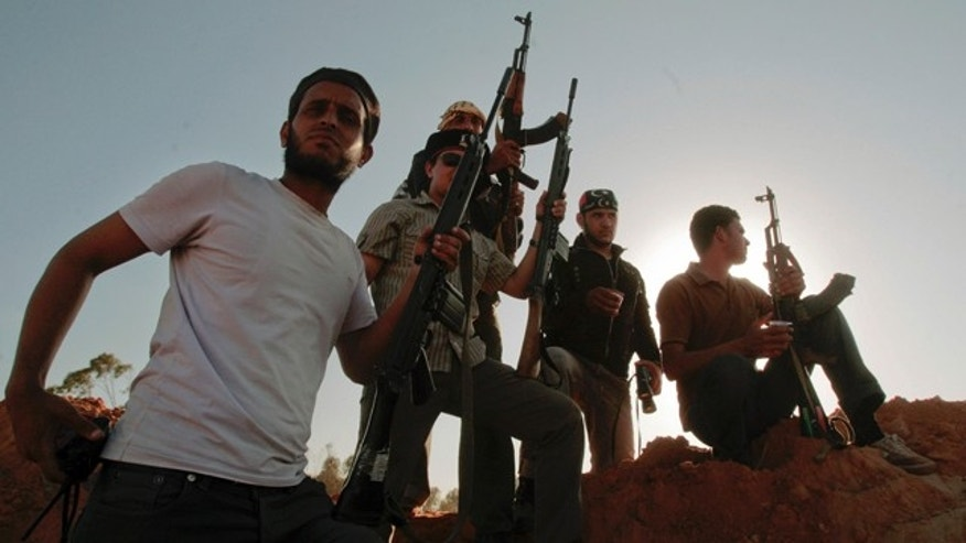 June 9: Libyan rebel fighters stand at their position at the southern front line of the city of Misrata, Libya.