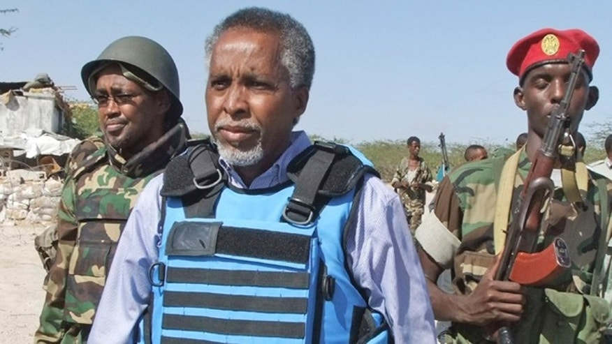 Feb. 23: Somalia's Interior Minister Abdishakur Sheik Hassan, center, is escorted by Somali soldiers in Mogadishu, Somalia.