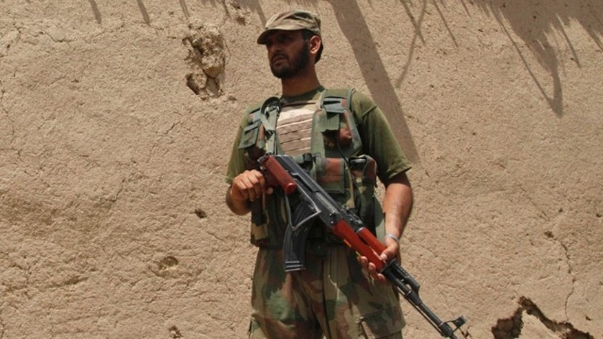 June 9: A Pakistan army soldier stands guard at the site of a blast in Matani near Peshawar, Pakistan.