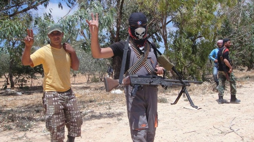 June 12: Rebel fighters are seen before a heavy fight against pro-Qaddafi forces at the frontline of Dafneya, some 40 km west Misrata, Libya.
