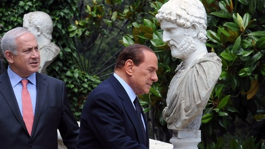 June 13: Italian Prime Minister Silvio Berlusconi with his Israeli counterpart Benjamin Netanyahu as they walk in the garden of Villa Madama during an Italy-Israel summit in Rome.