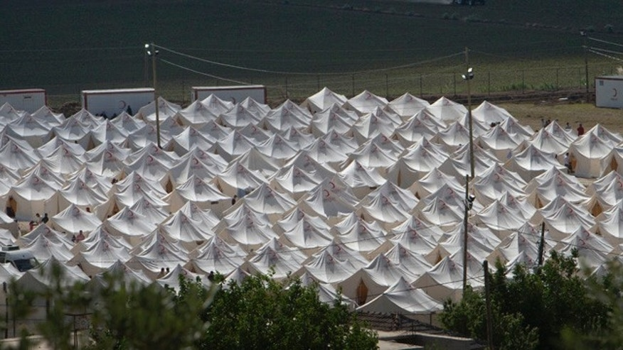 June 13: Syrian refugee developed tent compounds in Boynuyogun, Turkey, near the Syrian border to escape violence within Syria. According to Turkey's Foreign Ministry, the number of Syrians that fled their country seeking refuge in Turkey climbed to nearly 6,000.