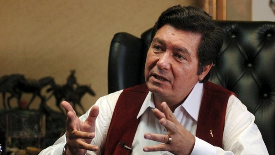 June 13, 2006: Then-Tijuana Mayor Jorge Hank Rhon in his City Hall office during an interview with The Associated Press, in Tijuana, Mexico. A Mexican official says that Hank Rhon has been arrested on suspicion of illegal weapons possession. Rhon was mayor of Tijuana from 2004 to 2007. He is a self-proclaimed billionaire who owns a dog-track and chain of gambling parlors.  (AP)