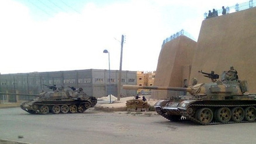 June 14: In this citizen journalism image made on a mobile phone and provided by Shaam News Network and with information according to them, showing a Syrian army tank deployed in the Syrian eastern province of Deir el-Zour, Syria.